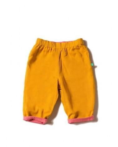 Pantalone per bambini in cotone biologico reversibile. Ocra e salmone
