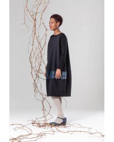 Abito nero con inserti in lana manica lunga sartoria italiana.