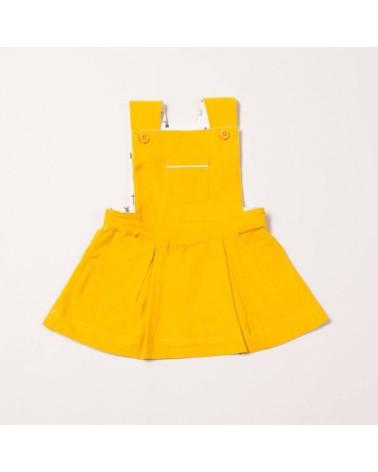 Salopette gialla con gonna per bambina in velluto di cotone biologico equosolidale. 12-18 mesi